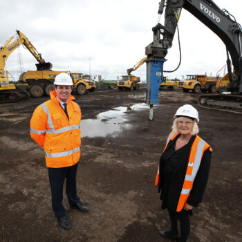 13 - Mayor Houchen with Cllr Lanigan in front of the heavy machinery used to remediate the land